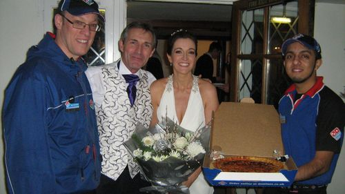 Happy newly weds Kendra & Mark with a Domino's Pizza