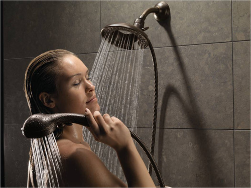 Delta(R) Faucet In2ition(R) Showerhead in Venetian Bronze(R).  (PRNewsFoto/Delta Faucet Company)