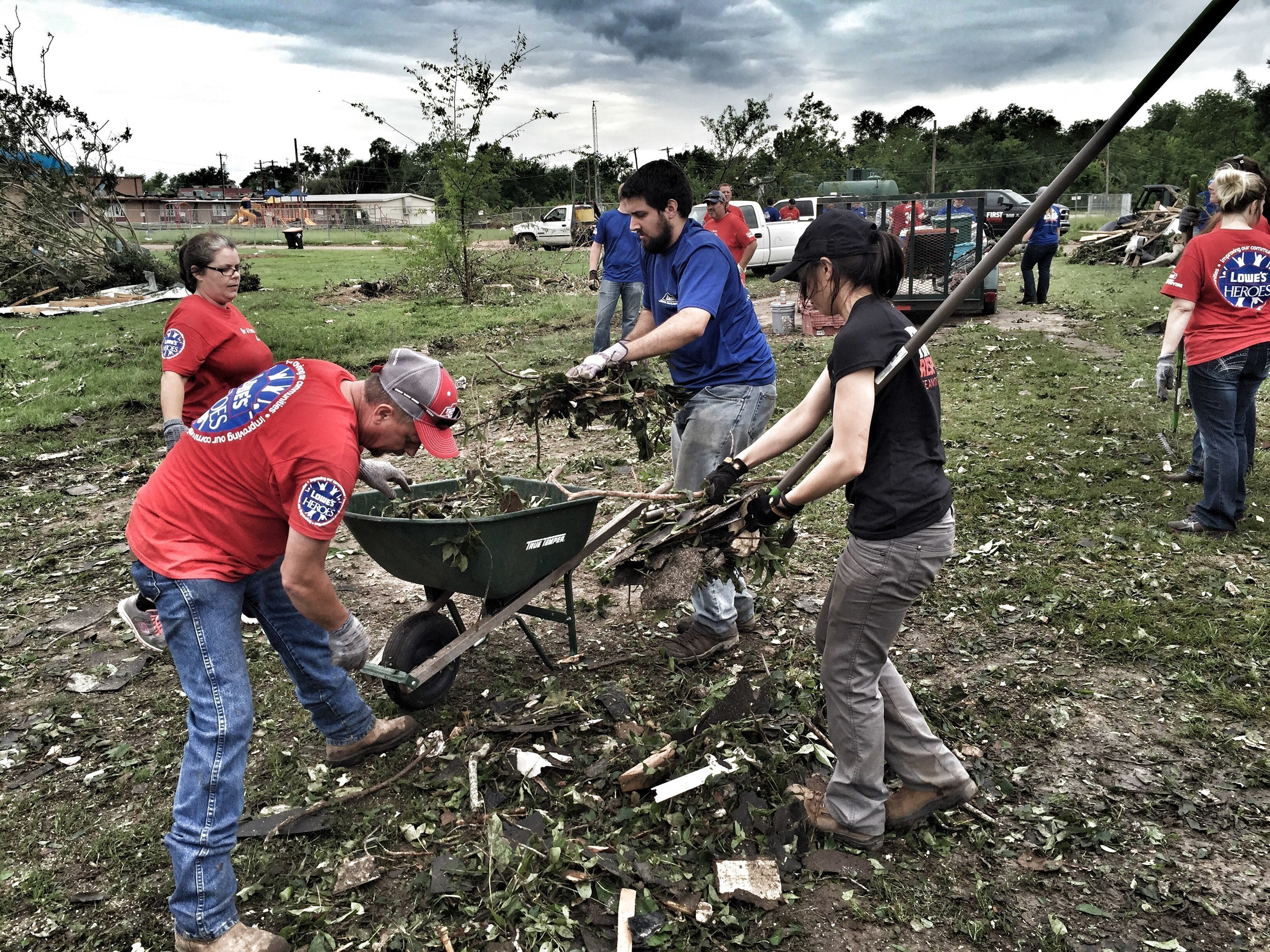 The First Response Team and Lowe's Heroes employee volunteers have their hands full cleaning up a property after a tornado hit Van, Texas. Lowe's donated $750,000 to aid the team's disaster relief efforts for the fourth consecutive year.