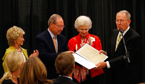 From left to right, Honey Alexander, Jimmy G. Cheek, Natalie Haslam and Lamar Alexander during the presentation of the original sheet music.  (PRNewsFoto/University of Tennessee)