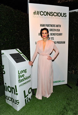Emmy Rossum helps celebrate the launch of H&M's garment recycling program at Global Green USA's 10th annual Pre-Oscar party.  (PRNewsFoto/H&M)