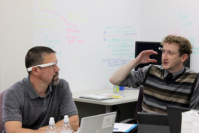 Employees in the Erie Insurance Commercial Risk Control group discuss a new program in which managers employ Google Glass to provide remote underwriting guidance to field consultants(left, Ron Dietrich, senior risk control consultant, Erie Insurance; right, Brett McCorkle, IT analyst, Erie Insurance)