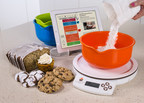"""With Perfect Bake(TM) by Pure Imagination, users simply place one of the three included color-coded mixing bowls on the smart digital scale, and then pour their flour, sugar, vanilla and other ingredients needed directly into the bowl. As an ingredient is poured, the virtual bowl in the Perfect Bake app on their tablet or smartphone fills up in real-time, showing progress. """"Ding!"""" An audio alert tells the user it's time to stop. (PRNewsFoto/Pure Imagination, LLC)"""