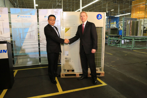 Jiro Tomita, Director and Senior Executive Officer of Daikin Industries LTD, congratulates Sam Bickman, Senior Vice President Operations and Logistics Daikin North American LLC, on the delivery of the first VRV heat pump assembled in North America.  (PRNewsFoto/Daikin North America LLC)