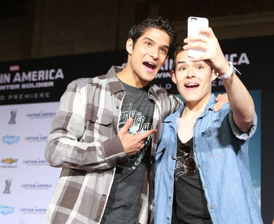 """Celebrity host Tyler Posey and a Captain America fan pose for a selfie at Marvel's Captain America: The Winter Soldier surprise """"for fans only"""" red carpet event. For the first time ever, Harley-Davidson and Marvel kept the red carpet open so fans could walk in the footsteps of their favorite stars. (PRNewsFoto/Harley-Davidson Motor Company) (PRNewsFoto/HARLEY-DAVIDSON MOTOR COMPANY)"""
