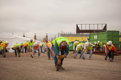 Safety first! Construction workers at Skanska stretch and prepare for their day. Photo Credit: Diana Rothery