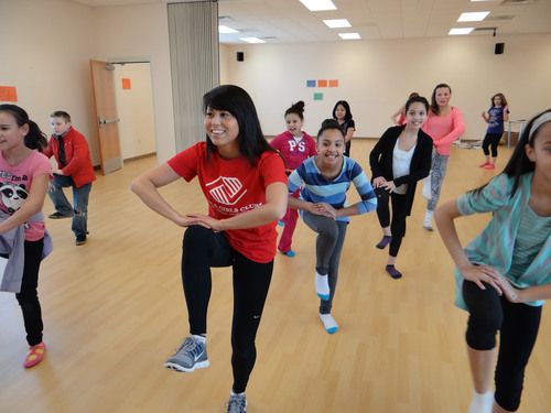 Young people from Boys & Girls Clubs of Central Minnesota have fun while learning hip hop and step dance as ...