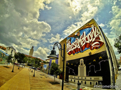 "The first piece of the #besomebody ""tagging the world"" Global Graffiti Expedition, at the University of Texas at Austin campus, painted on the side of the 40-foot high University Co-op building. The University of Texas is one of the largest universities in the world, with more than 50,000 enrolled students. Austin is the global headquarters for the #besomebody movement."