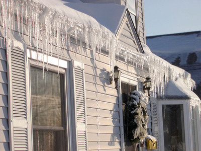 What is an ice dam? An ice dam is caused when heat loss through a poorly insulated attic melts the ice and snow above the attic space and it refreezes on the colder sections of the roof near the eaves.  (PRNewsFoto/The Hanover Insurance Group, Inc.)