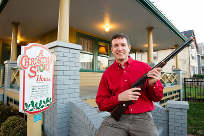 Museum owner Brian Jones holds the Red Ryder BB Gun used in the movie at A Christmas Story House and Museum on Monday, Nov. 16, 2015 in Cleveland. The Museum has recently acquired the movie prop and added it to their collection. (Jason Miller/AP Images for A Christmas Story House and Museum)