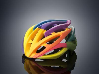 Bike helmet 3D printed on the Objet500 Connex3 Color Multi-material 3D Printer in one print job using VeroCyan, VeroMagenta, and VeroYellow