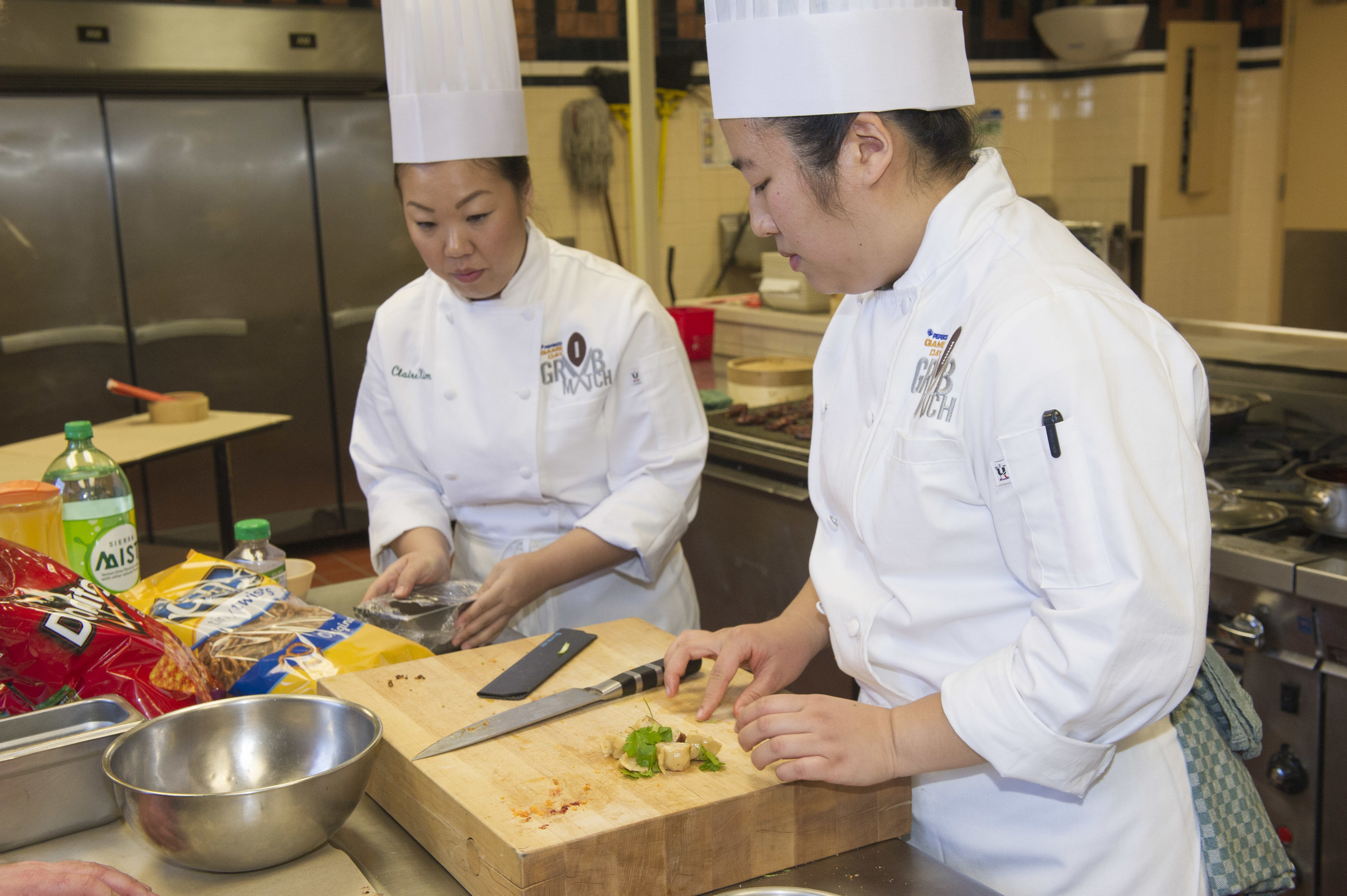 Students from The Culinary Institute of America in the kitchen, competing for a trip to Super Bowl 50 in PepsiCo's Game Day Grub Match.