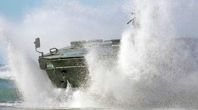 Lockheed Martin's Havoc 8x8, an eight-wheel-drive Armored Modular Vehicle, successfully completed amphibious testing as part of its evaluation for the Marine Personnel Carrier competition.  (PRNewsFoto/Lockheed Martin)