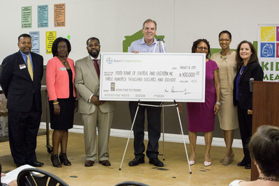 Bayer CropScience presents check for $300,000 to Food Bank of Central and Eastern North Carolina.