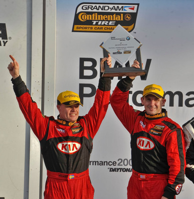 Kia Racing's Nic Jonsson (left) and Andy Lally (right) reached the podium for the second straight year at Daytona International Speedway in the Continental Tire Sports Car Challenge on Friday, January 27, 2012 with a second place finish in the #10 Kia Forte Koup.  (PRNewsFoto/Kia Motors America)