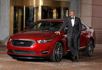 Comedian Steve Harvey with the New 2013 Taurus SHO.  (PRNewsFoto/Ford Motor Company)
