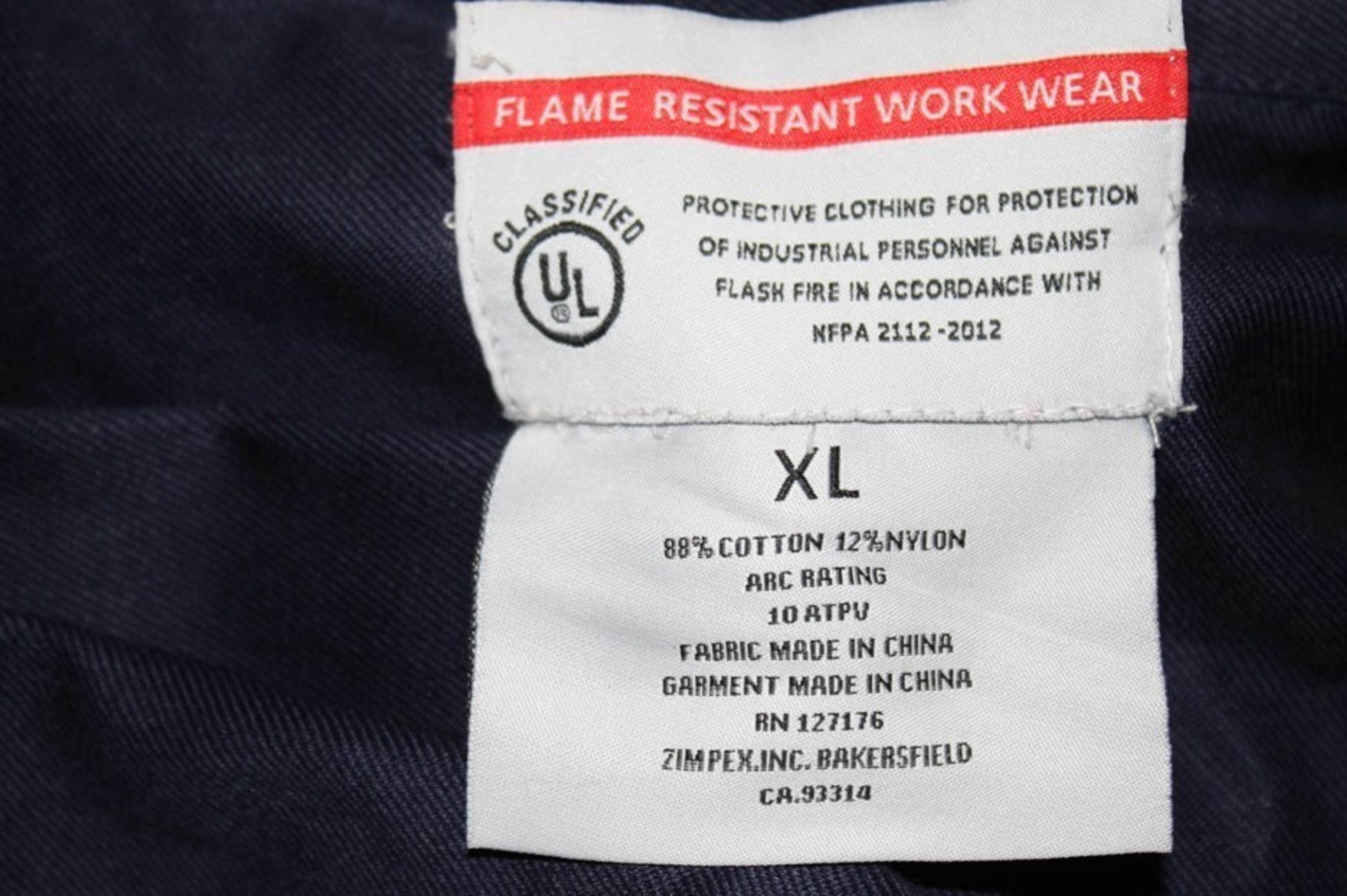 Picture of counterfeit UL label on collar of coveralls:
