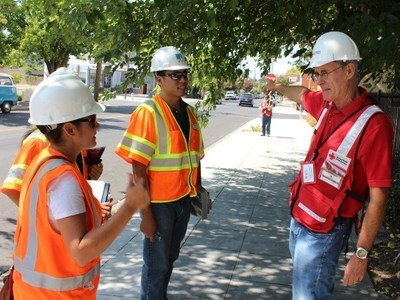 PG&E employees and an American Red Cross representative work together during the Napa earthquake response effort.