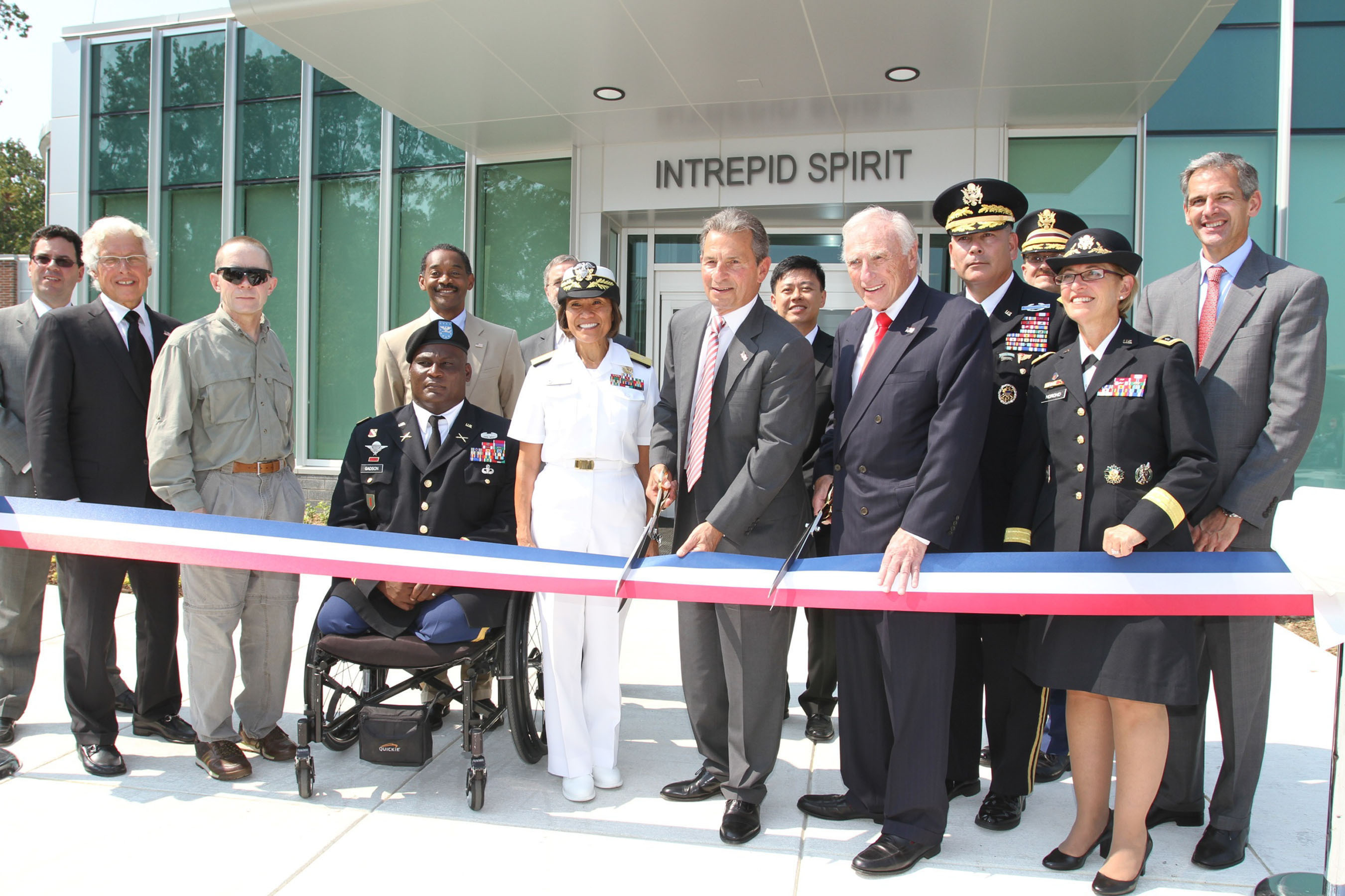From left to right: Mr. Dave Winters, President of the Intrepid Fallen Heroes Fund; Mr. Martin Edelman, Trustee, Intrepid Fallen Heroes Fund; SGM Robert Haemmerle, Army; COL. Gregory Gadson, Garrison Commander, Ft. Belvoir; Dr. Jonathan Woodson, Assistant Secretary of Defense Health Affairs and Director of TRICARE Management Activity; ADM Raquel Bono, Commander of Joint Task Force National Capital Region Medical; *in background: Dr. Jim Kelly, Director of the National Intrepid Center of Excellence; Mr. Rich Santulli, Chairman, Intrepid Fallen Heroes Fund; Mr. Arnold Fisher, Honorary Chairman, Intrepid Fallen Heroes Fund; *in background: Dr. Heechin Chae, Director, Intrepid Spirit; GEN John Campbell, Vice Chief of Staff of the Army; LTG Patricia Horoho, Surgeon General of the Army; COL Charles Callahan, Commander, Ft Belvoir Hospital; Mr. Horoho. (PRNewsFoto/Intrepid Fallen Heroes Fund) (PRNewsFoto/INTREPID FALLEN HEROES FUND)