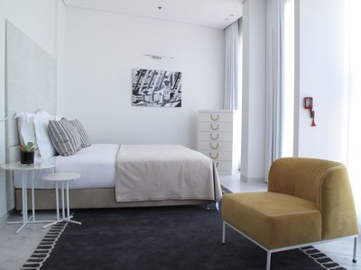 The new 65 Hotel on Rothschild Boulevard (an Atlas Boutique Hotel) in Tel Aviv offers guests luxurious comfort with a unique design experience. Four white floors contrast four brown floors within the eight floor round building. (PRNewsFoto/Atlas Boutique Hotels)