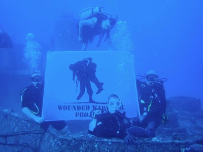 Wounded veterans share the Wounded Warrior Project logo near the Sea Tiger, off the coast of Oahu