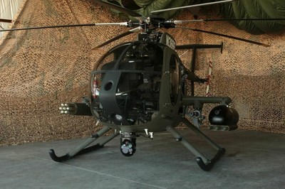 The MD 530G Scout Attack helicopter is a fully integrated gunship with a highly capable, customizable mission equipment package including the Moog Stores Management System (SMS), the Mace Aviation Extended Range Weapons Wing, FN Herstal Machine Gun Pods and Rocket Machine Pods, Dillon Aero M134D-H Mini-Gun, the L-3 Wescam MX-10D, and M260 rocket pod.   (PRNewsFoto/MD Helicopters Inc.)