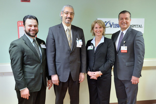 Vibra Hospital, which opened on the second floor of Oakwood Hospital-Taylor, holds a grand opening celebration on February 12, 2014. L to R: Hani Ayyad, cco, Vibra, Mohammad Elmenini, MD, Denise Wayne, ceo, Vibra of Southeastern Michigan and Belal Abdallah, MD, Oakwood Healthcare.  (PRNewsFoto/Vibra Healthcare, LLC)