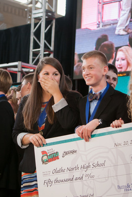 """An Olathe North High School student is speechless after learning her team's proposal earned their school $50,000 and will be built as a real-life science exhibit at Science City. The """"Tapped Out"""" exhibit will highlight how to preserve our planet's most valuable resource - water. (PRNewsFoto/Burns & McDonnell Foundation) (PRNewsFoto/BURNS & MCDONNELL FOUNDATION)"""