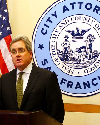 San Francisco City Attorney Dennis Herrera answers questions at a City Hall press conference.