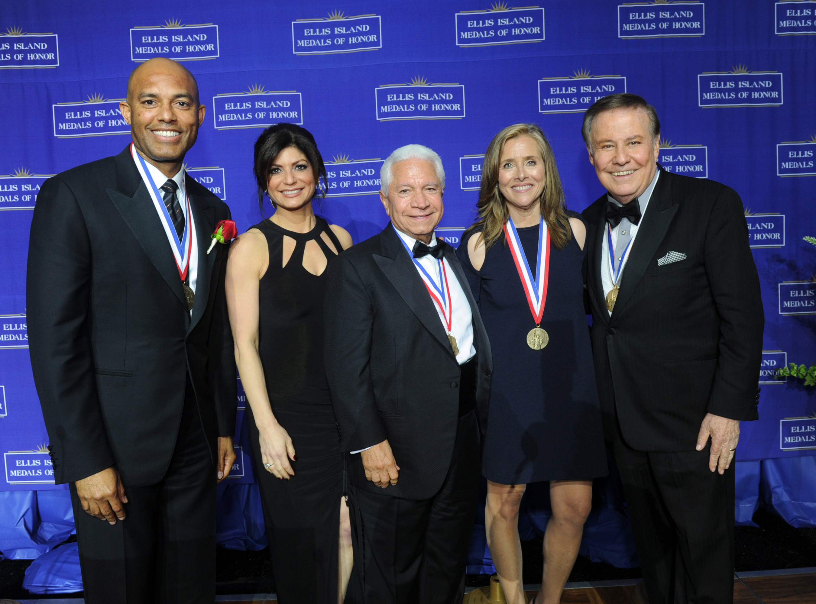 Honorees Mariano Rivera, left, New York Yankees legend, and Meredith Vieira, second right,journalist, pose with NECO chairman Nasser J. Kazeminy, center, and co-hosts from PIX11 Tamsen Fadal, second left, and Marvin Scott,right, at the National Ethnic Coalition of Organizations' 2015 Ellis Island Medal of Honor awards ceremony on Ellis Island, Saturday, May 9, 2015.  Rivera and Vieira were among 101 recipients honored.  NECO's mission is to honor and preserve the diversity of the American people and to foster tolerance, respect and understanding among religious and ethnic groups. (Photo by Diane Bondareff/Invision for NECO/AP Images)