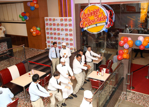 Johnny Rockets servers dancing at new Karachi location. (PRNewsFoto/Johnny Rockets)