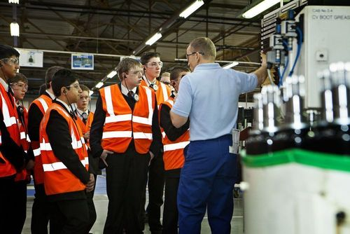 GKN Driveline shift leader Paul Fallon shows Barr Beacon School pupils around an assembly cell (PRNewsFoto/GKN Driveline)