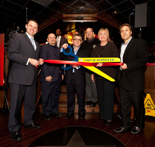 T.G.I. Friday's in Westbury celebrates its grand re-opening with an official ribbon cutting on Thursday, ...