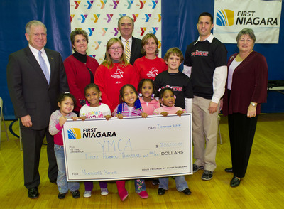 First Niagara contributed $300,000 to support volunteer recruitment for YMCA youth mentoring programs throughout southeastern Pa. Left to right: John Flynn, president and CEO, YMCA of Philadelphia and Vicinity; Charlene McCaw, mother of mentee Adrianna McCaw; Adrianna McCaw, YMCA of the Brandywine Valley Girls on the Run mentee; Robert D. Kane, regional president, First Niagara Eastern Pennsylvania; Gina Reid, YMCA of the Brandywine Valley Girls on the Run mentor; Asher Moore, YMCA of the Brandywine Valley Stride mentee; Ryan Kulesza, YMCA of the Brandywine Valley Stride mentor; Jean Hunt, director of City Wide Youth Development; and other YMCA program participants.  (PRNewsFoto/First Niagara)