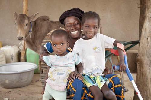 "Roukiatou (on the right-hand side) and her family. Every third child of primary school age without access to education has a disability; 150 million children worldwide live with a disability. Eighty percent of them live in developing countries and 9 out of 10 never have the chance to get an education. In order to break the cycle of poverty, the disability and development organization LIGHT FOR THE WORLD supports global efforts to ensure education for every child. Visit us at: www.light-for-the-world.org. picture credit :  ""Ulrich Eigner"" (PRNewsFoto/LIGHT FOR THE WORLD)"