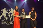 Mr. Krishna Srivastava, Director, (Sales and Marketing),Zuari Cement, receiving The POWER BRANDS 2012 Award from Ms. Parineeti Chopra