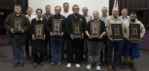 C.R. England honors 2013 Drivers of the Year; front row L-R:  Richard Sweeney, Chuck Stubbs, Kenneth Peri, ...
