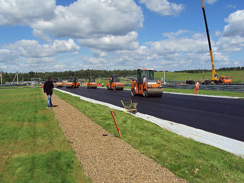 Rollers put final touches on pavement compaction at the Moscow Raceway.  (PRNewsFoto/Kraton Performance ...