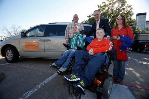 Amy and Brian Ozbirn and their sons, Joshua and Austin Riley pose with Turner Sports broadcaster Ernie Johnson   ...