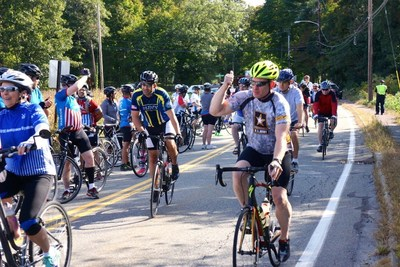 WWP supporters wave as they participate in a Soldier Ride Community Ride event.
