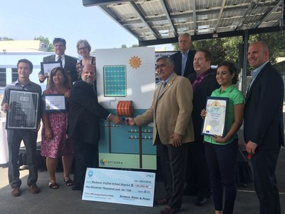"Members of the Burbank community, including the Board of Education President Larry Applebaum, Mayor Jess Talamantes, Superintendent Matt Hill, and OpTerra Energy Services partners and student interns ""flip the switch"" on renewable energy at the Burbank Adult School."