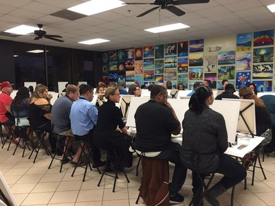 Wounded Warrior Project Alumni prepare to paint their masterpieces at Wine and Canvas.