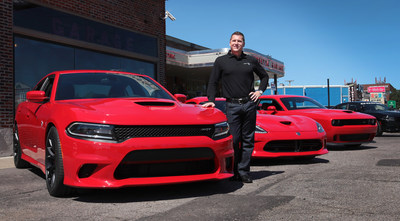 """Berkley (Mich.) -- August 13, 2014 -- """"Tim Kuniskis, President and CEO, Dodge and SRT brands, unveiled the 2015 Dodge Charger SRT Hellcat, left, today. The Charger's supercharged 6.2-liter HEMI(R) Hellcat engine produces 707 horsepower and delivers unrivaled four-door performance with a quarter mile elapsed time of 11.0 seconds on production tires and a top speed of 204 mph. Also pictured are the 2014 Dodge Viper SRT, center, and 2015 Dodge Challenger SRT Hellcat, right. (PRNewsFoto/Chrysler Group LLC)"""