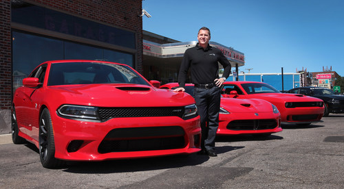 "Berkley (Mich.) -- August 13, 2014 -- ""Tim Kuniskis, President and CEO, Dodge and SRT brands, unveiled the 2015 Dodge Charger SRT Hellcat, left, today. The Charger's supercharged 6.2-liter HEMI(R) Hellcat engine produces 707 horsepower and delivers unrivaled four-door performance with a quarter mile elapsed time of 11.0 seconds on production tires and a top speed of 204 mph. Also pictured are the 2014 Dodge Viper SRT, center, and 2015 Dodge Challenger SRT Hellcat, right. (PRNewsFoto/Chrysler Group LLC)"