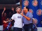 "SPC Lane sings ""God Bless the USA"" with Lee Greenwood in front of his new home in Canyon Lake, TX (PRNewsFoto/Spark Energy)"