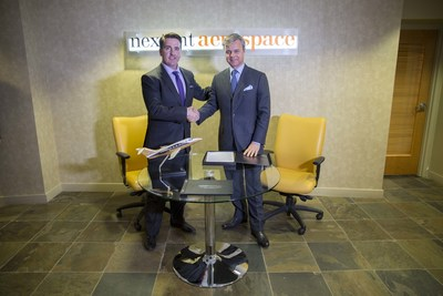 Nextant President and CEO Sean McGeough and PlaneSense President and CEO George Antoniadis shake hands after signing the purchase agreement.