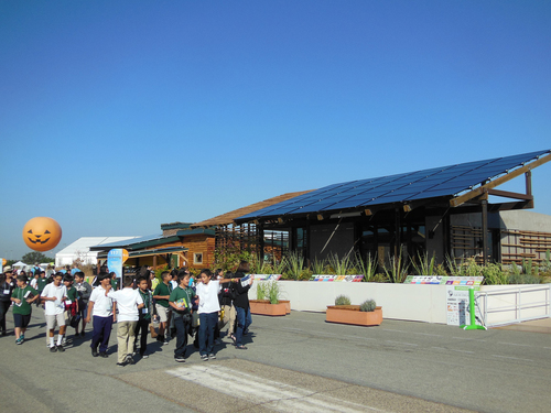 Students from a local elementary school tour the SHADE house designed and built by the University of New Mexico  ...
