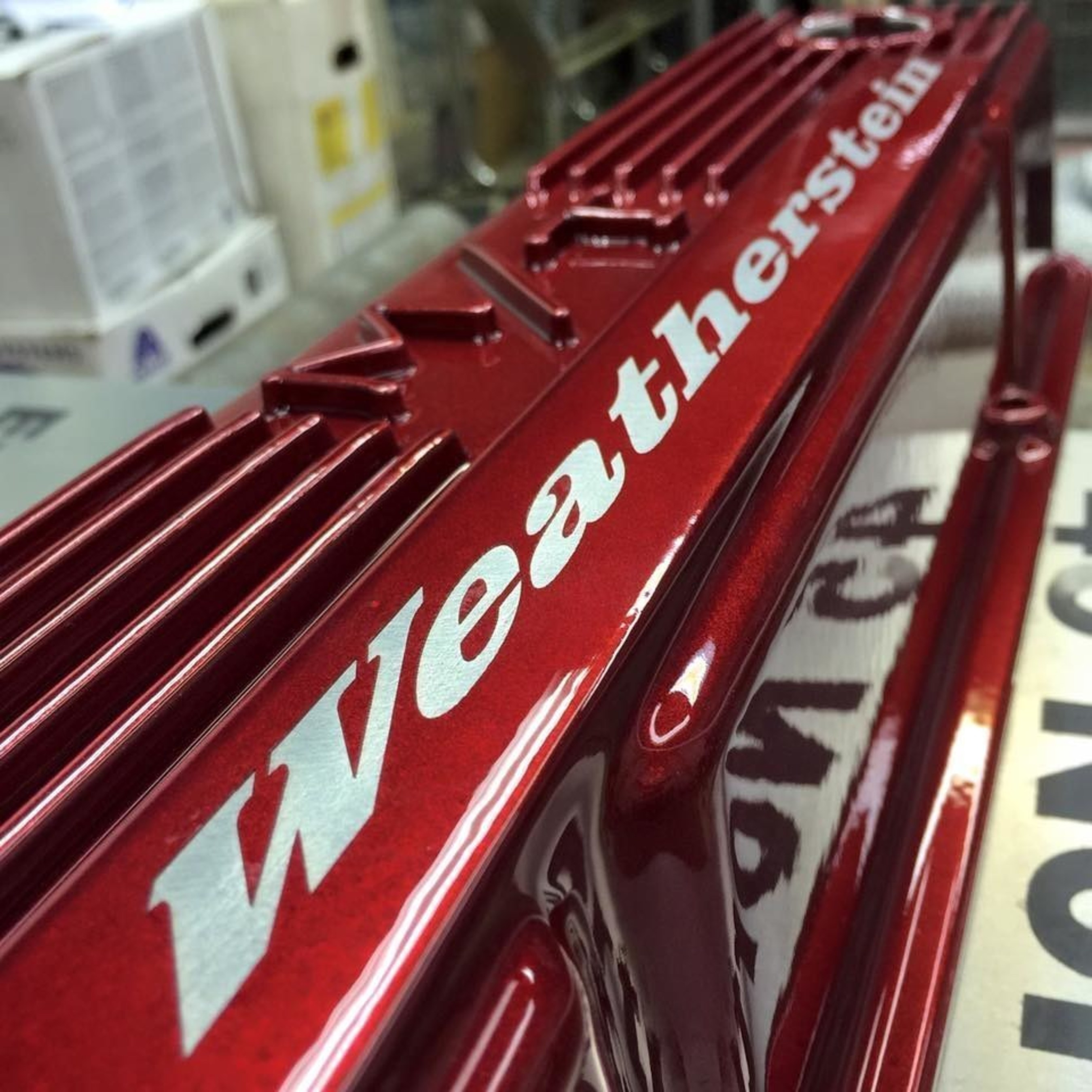AP LAZER engraved a customers name on their candy red valve cover - photo courtesy of Powder Coat Finishes, LLC