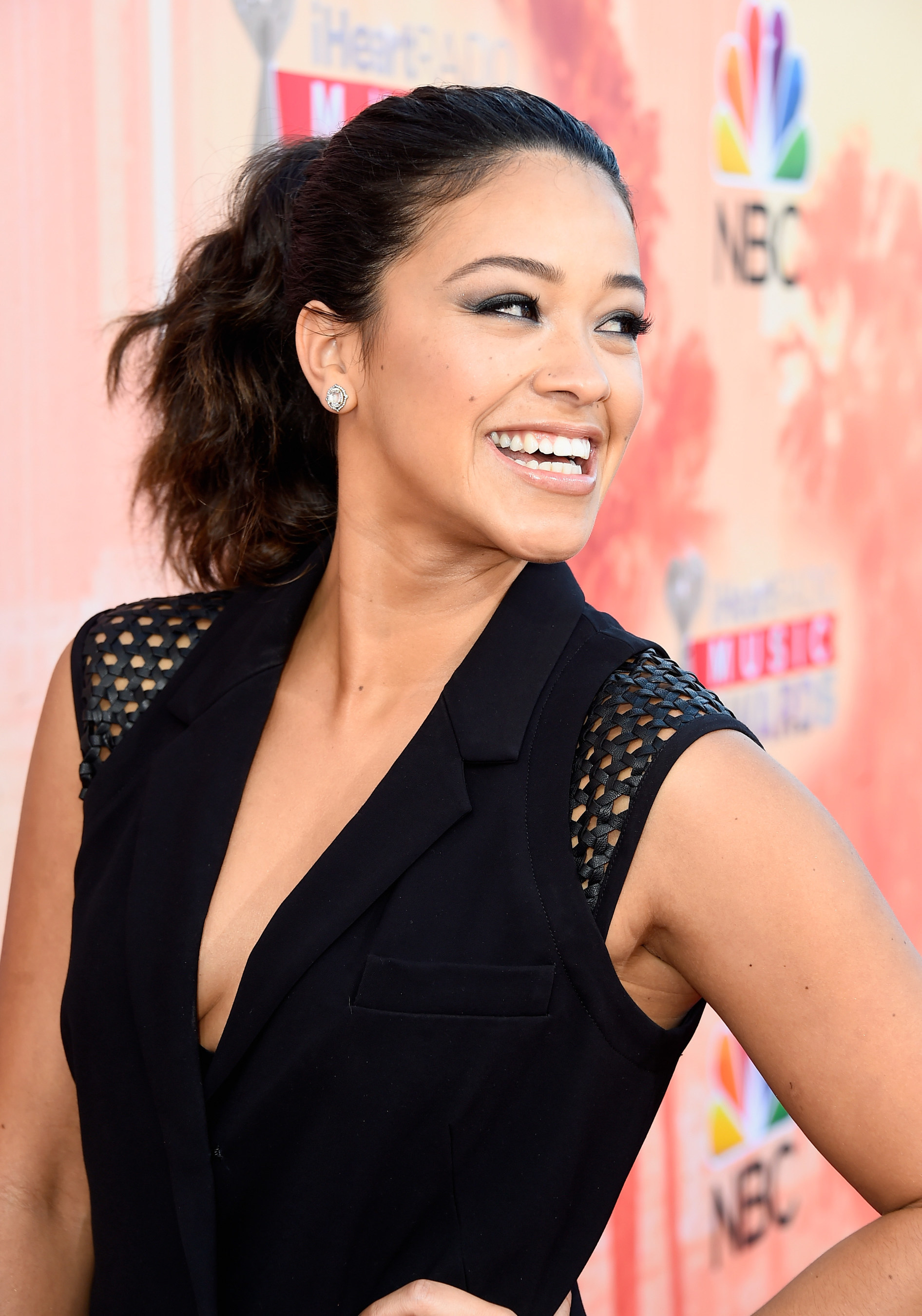 """Gina Rodriguez, star of """"Jane the Virgin,"""" supports CustomInk's 2015 """"Be Good to Each Other"""" bullying prevention campaign. Photo by Frazer Harrison / Getty Images Entertainment / Getty Images"""