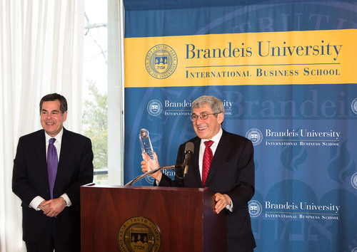 Dean Bruce Magid, Dean of Brandeis International Business School (L), presents Stanley Bergman, Chairman of the Board and Chief Executive Officer of Henry Schein, Inc., with the 2013 Perlmutter Award for Excellence in Global Business Leadership from the Perlmutter Institute at Brandeis International Business School. (Photo by Sharona Jacobs).  (PRNewsFoto/Brandeis International Business School)
